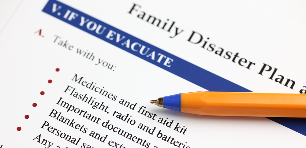 Family Disaster Plan and ballpoint pen. Close-up.